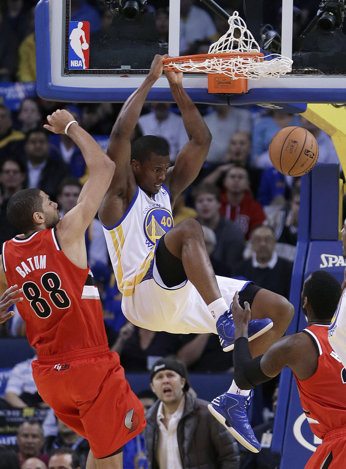 Golden State Warriors' Harrison Barnes (40) scores next to Portland Trail Blazers' Nicolas Batum (88) during the first half of an NBA basketball game Friday, Jan. 11, 2013, in Oakland, Calif. (AP Photo/Ben Margot)