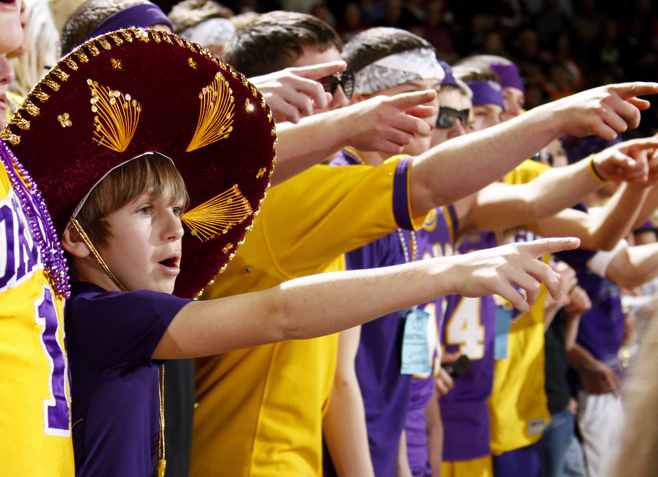 Photo - Kyle Pfaff, 11, of Okarche cheers for his team during the Class A girls basketball state tournament at the State Fair Arena in Oklahoma City, Friday, March 5, 2010.  Photo by Bryan Terry, The Oklahoman