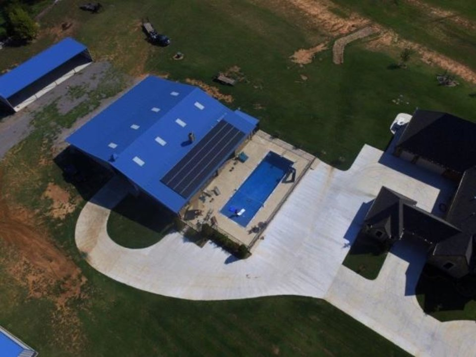 Photo -  Systems can be installed on various types of structures. This installation was done on a building behind a Yukon home. [PROVIDED BY SOLAR POWER OF OKLAHOMA]