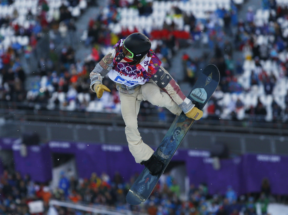 Photo - Shaun White of the United States competes during the men's snowboard halfpipe qualifying session at the Rosa Khutor Extreme Park, at the 2014 Winter Olympics, Tuesday, Feb. 11, 2014, in Krasnaya Polyana, Russia. (AP Photo/Sergei Grits)