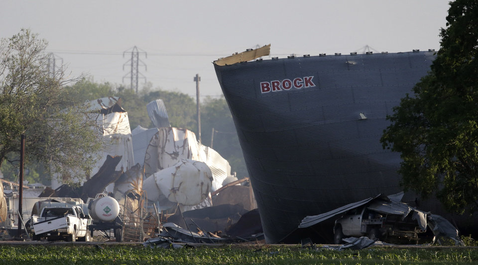 Photo - Mangled debris of a fertilizer plant are seen Thursday, April 18, 2013, a day after an explosion leveled the plant in West, Texas. The massive explosion at the West Fertilizer Co. Wednesday night killed as many as 15 people and injured more than 160. (AP Photo/Charlie Riedel)