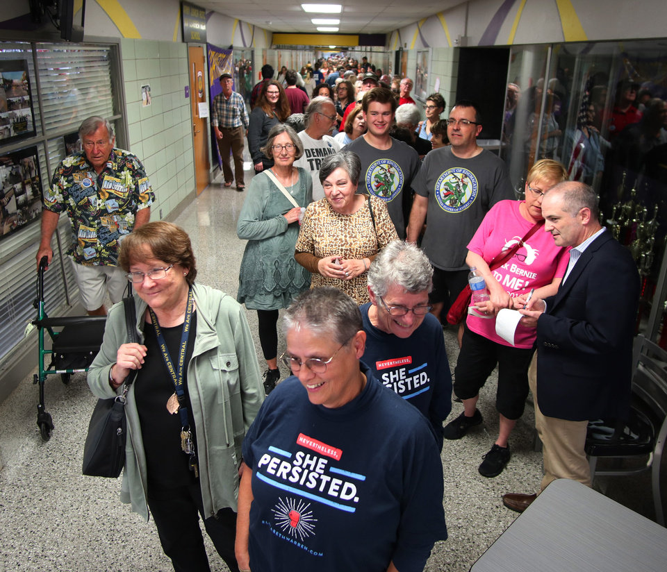 Photo - People fill the main hallway at NWC waiting in line for the AFT education rally at Northwest Classen High School, Saturday, September, 22, 2018.  Photo by Doug Hoke, The Oklahoman