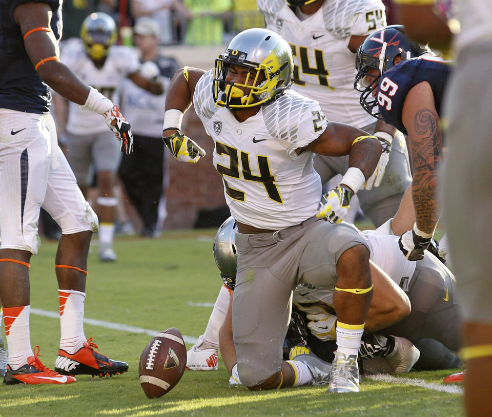 Oregon running back Thomas Tyner (24) celebrates a touchdown against Virginia during the second half of an NCAA college football game at Scott Stadium, Saturday, Sept. 7, 2013, in Charlottesville, Va. (AP Photo/Andrew Shurtleff)