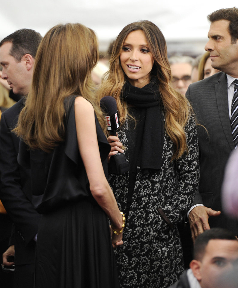 "Television journalist Giuliana Rancic, right, interviewing Angelina Jolie at the premiere of ""In The Land of Blood and Honey"" at The School of Visual Arts Theater on Monday, Dec. 5, 2011 in New York. (AP Photo/Evan Agostini)"