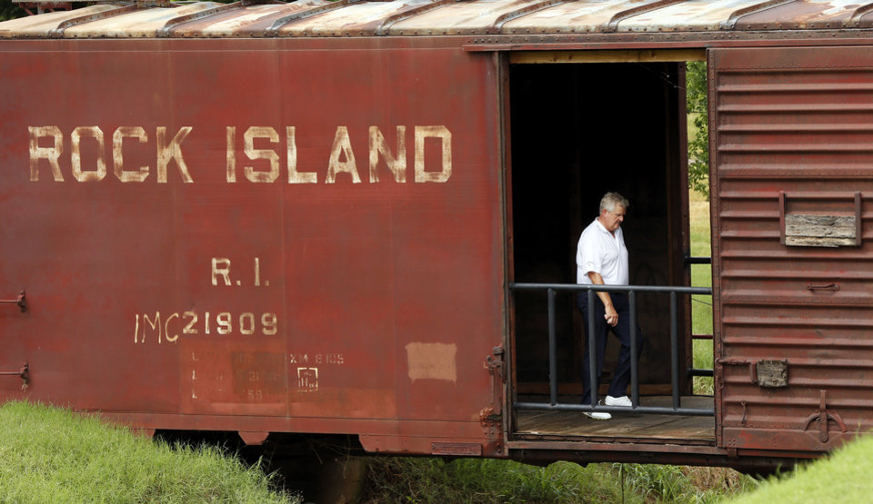 Photo - Colin Montgomerie walks through the railroad car between No. 6 and No. 7 during practice rounds for the U.S. Senior Open golf tournament at Oak Tree National in Edmond, Okla., Wednesday, July 9, 2014. Photo by Nate Billings, The Oklahoman