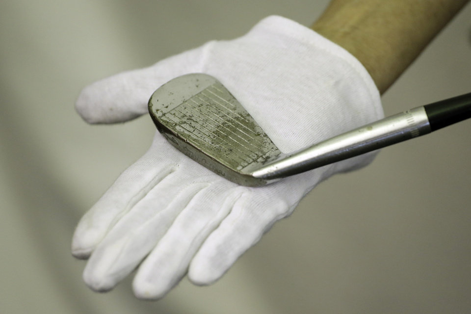Photo - Ben Hogan's 1-iron is shown at the U.S. Open golf tournament at Merion Golf Club, Wednesday, June 12, 2013, in Ardmore, Pa. Good luck finding a player who even carries a 1-iron. And the shot Hogan hit in 1950 at Merion, which the USGA estimates to be 213 yards, is no longer a 1-iron. (AP Photo/Darron Cummings)