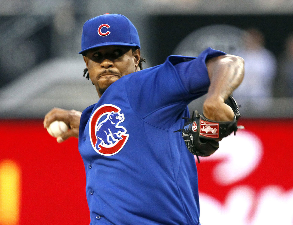 Photo - Chicago Cubs starting pitcher Edwin Jackson pitches in the first inning of a baseball game against the San Diego Padres, Friday, May 23, 2014, in San Diego. (AP Photo/Don Boomer)