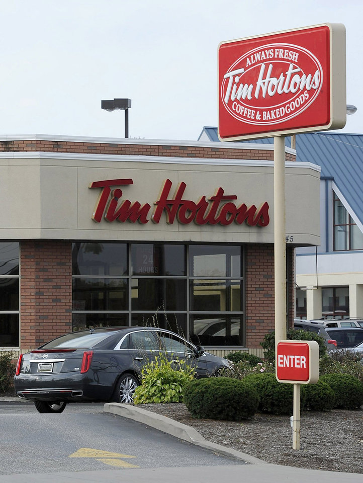 Photo - A Tim Hortons restaurant is seen on W. 26th Street in Millcreek Township, Pa., on Tuesday, Aug. 26, 2014. Burger King struck an $11 billion deal to buy Tim Hortons that would create the world's third largest fast-food company and could make the Canadian coffee-and-doughnut chain more of a household name around the world. (AP Photo/Erie Times-News, Christopher Millette)