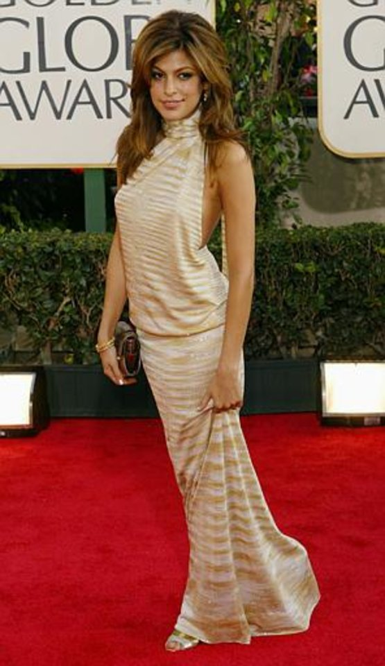 Actress and presenter Eva Mendes arrives for the 61st Annual Golden Globe Awards on Sunday, Jan. 25, 2004, in Beverly Hills, Calif.  (AP Photo/Kevork Djansezian)