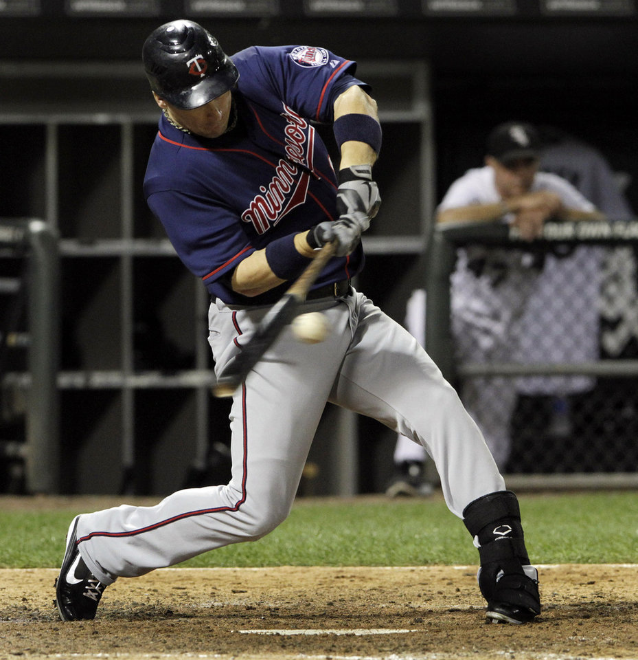 Photo -   Minnesota Twins' Josh Willingham singles during the fifth inning of a baseball game against the Chicago White Sox, Tuesday, Sept. 4, 2012, in Chicago. (AP Photo/John Smierciak)