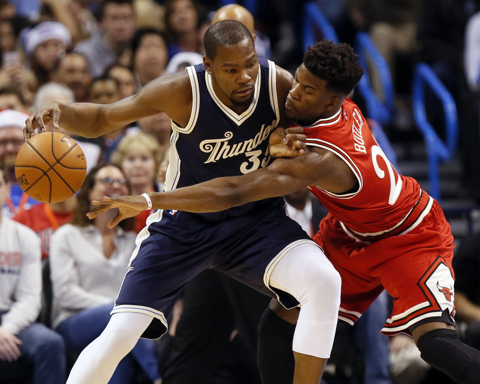 Photo - Chicago's Jimmy Butler (21) tries to steal the ball from Oklahoma City's Kevin Durant (35) during an NBA basketball game between the Oklahoma City Thunder and the Chicago Bulls at Chesapeake Energy arena in Oklahoma City, Friday, Dec. 25, 2015. Photo by Nate Billings, The Oklahoman
