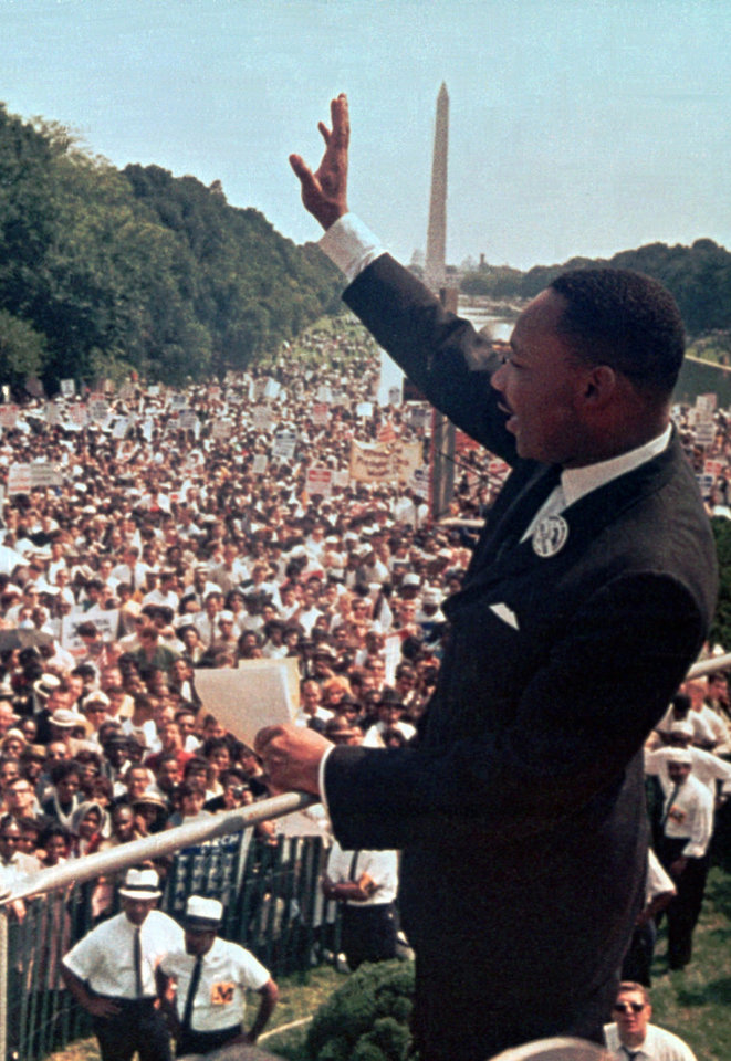 "FILE - In this Aug. 28, 1963 file photo, The Rev. Martin Luther King Jr. waves to the crowd at the Lincoln Memorial for his ""I Have a Dream"" speech during the March on Washington. The march was organized to support proposed civil rights legislation and end segregation. (AP Photo/File)"