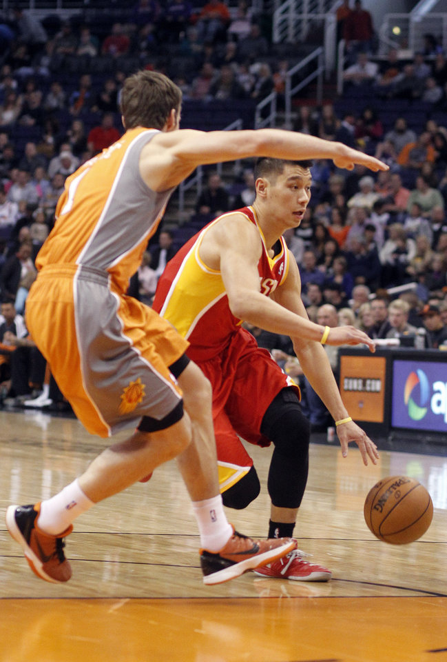 Houston Rockets guard Jeremy Lin, right, is guarded by Phoenix Suns guard Goran Dragic, left, of Slovenia, during the first half of an NBA basketball game Saturday, March 9, 2013, in Phoenix.(AP Photo/Paul Connors)