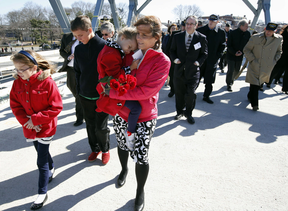 Photo - Raeann Melvin, center, of Harker Heights, Tex., walks with her daughters Cassidy, 9, left, and Cailey, 5, on the way to a wreath ceremony to mark the 50th anniversary of the sinking of the USS Thresher, Saturday, April 6, 2013. in Portsmouth, N.H. Melvin's father was one of the 129 men who died when the submarine went down. (AP Photo/Michael Dwyer)