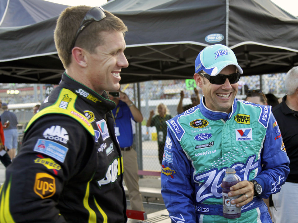 Photo -   Matt Kenseth, right, laughs with Carl Edwards, left, after winning the pole position for the NASCAR Sprint Cup Series auto race at Daytona International Speedway, Friday, July 6, 2012, in Daytona Beach, Fla. (AP Photo/Terry Renna)
