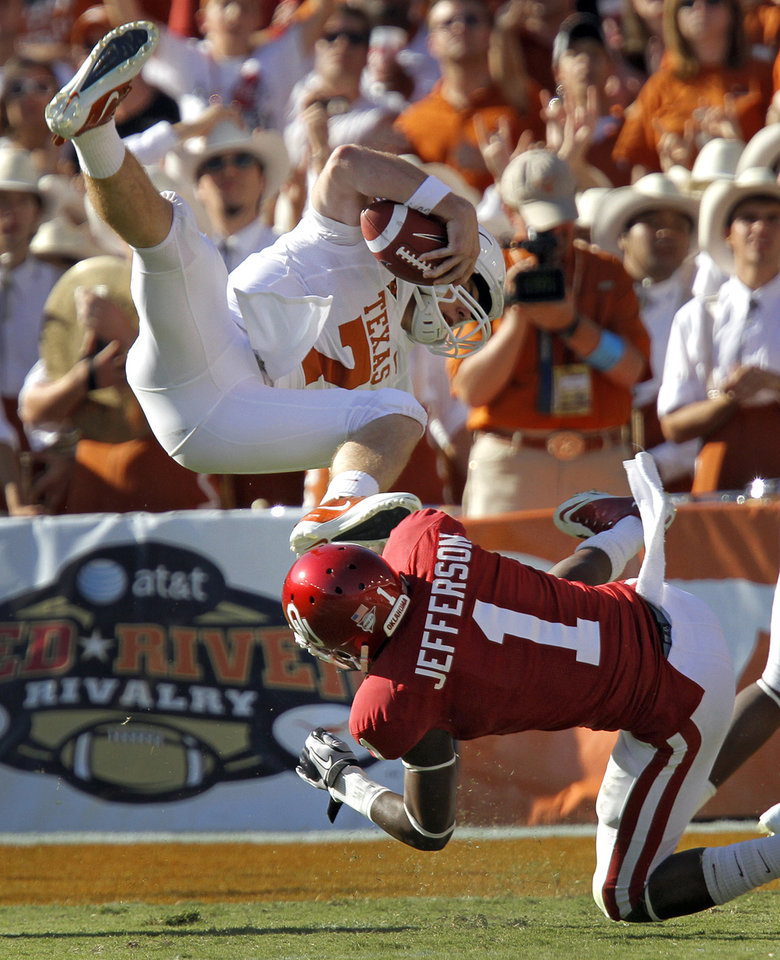 Oklahoma\'s Tony Jefferson (1) upends Texas quarterback Garrett Gilbert (7) in the second half of the Red River Rivalry college football game between the University of Oklahoma Sooners (OU) and the University of Texas Longhorns (UT) at the Cotton Bowl on Saturday, Oct. 2, 2010, in Dallas, Texas. Photo by Chris Landsberger, The Oklahoman