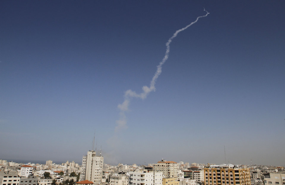 Photo -   Smoke trails are seen after a missiles was fired by Palestinian militants from Gaza City towards southern Israel, Sunday, Nov. 18, 2012. Israel continues to hold off on a ground campaign into the Gaza Strip even as it widens the scope of airstrikes. Israeli military aircraft attacked two buildings used by both Hamas and foreign media outlets on Sunday. (AP Photo/Hatem Moussa)
