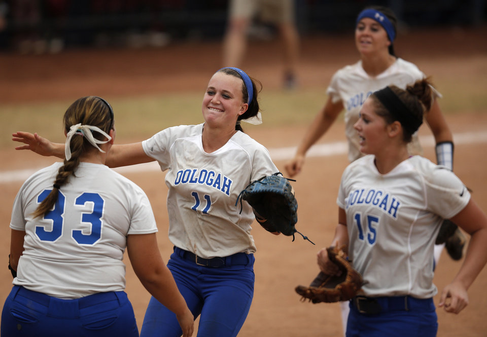 Photo - Ooloagah's Alex Edinger (11) celebrates with her teammates after winning a 4A state softball semifinals game between Oolagah-Talala and Tuttle at ASA Hall of Fame Stadium in Oklahoma City, Okla., Friday, Oct. 12, 2012.  Photo by Garett Fisbeck, The Oklahoman