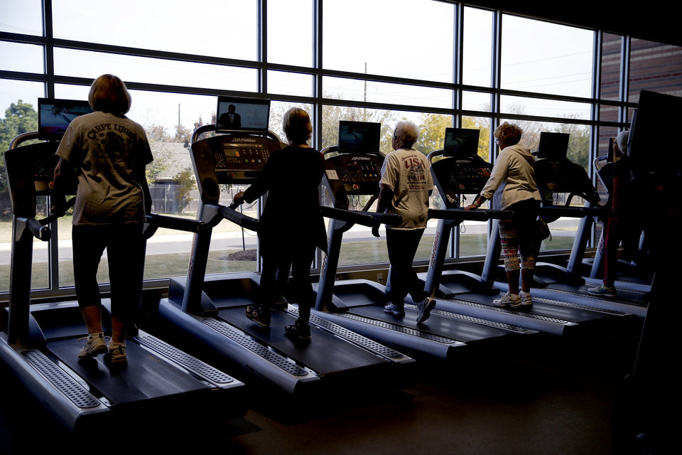 Photo - People exercise inside the gym area of the MAPS 3 Health and Wellness Center operated by Healthy Living & Fitness, Inc. on Thursday, Nov. 9, 2017. Photo by Bryan Terry, The Oklahoman