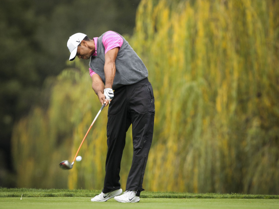 Photo - Tiger Woods tees off on the fifth hole during the second round of the World Challenge golf tournament at Sherwood Country Club in Thousand Oaks, Calif., Friday, Nov. 30, 2012. (AP Photo/Bret Hartman)
