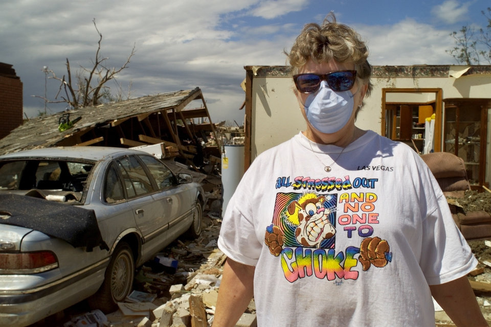 "MAY 3, 1999 TORNADO: Tornado victims, damage: Frances Unruh, With her ""All Stressed Out And No One To Choke"" T-Shirt cleans up at her sister's house at 6113 SE 9th in Midwest City."