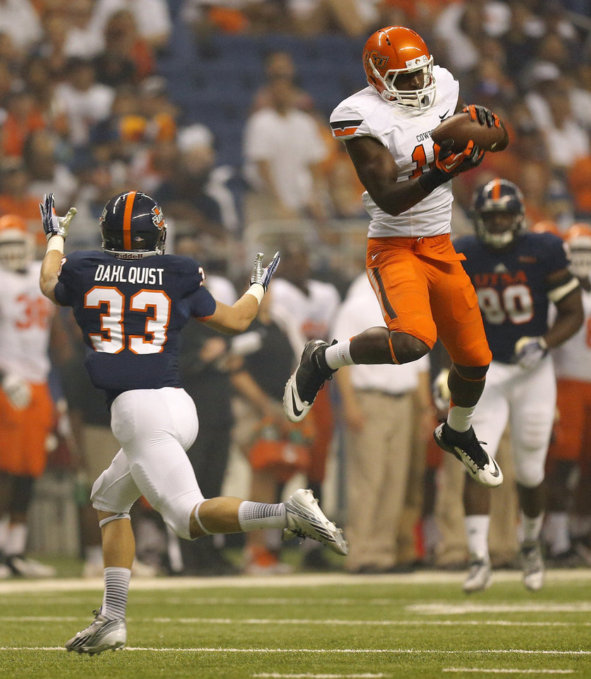 Photo - OSU's Blake Jackson (18) makes a catch for a first down in the third quarter near UTSA's Chase Dahlquist (33) during a college football game between the University of Texas at San Antonio Roadrunners (UTSA) and the Oklahoma State University Cowboys (OSU) at the Alamodome in San Antonio, Saturday, Sept. 7, 2013. OSU won, 56-35. Photo by Nate Billings, The Oklahoman