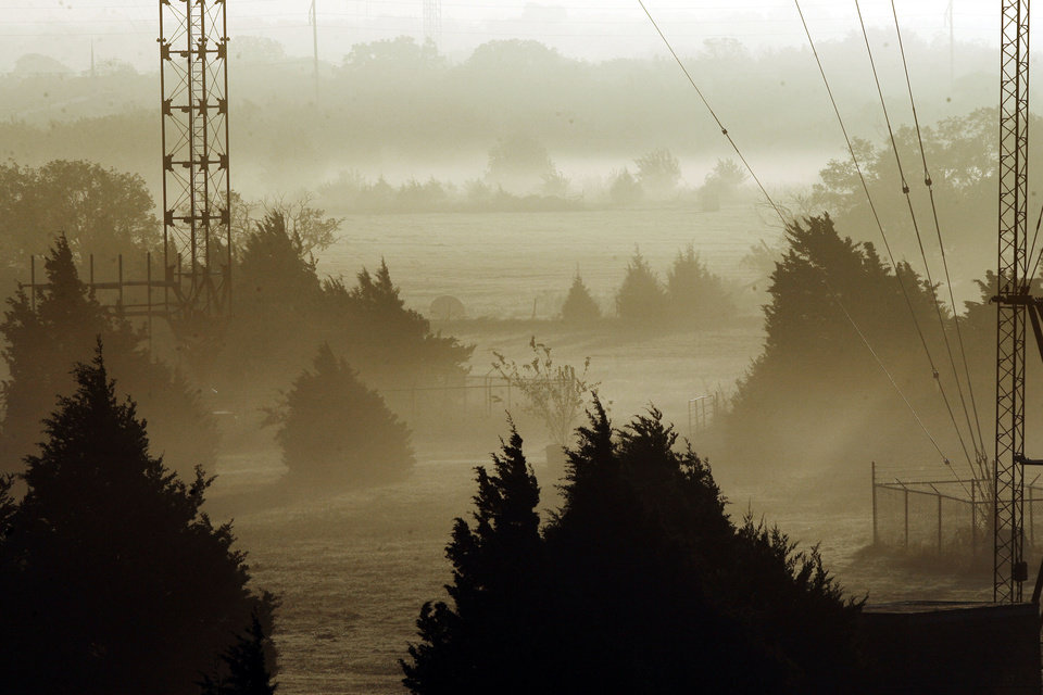 An early morning fog obscures the horizon near Britton Road and North Kelly in Oklahoma City, Okla., Tuesday, October 16, 2007. Photo by Paul Hellstern / The Oklahoman.
