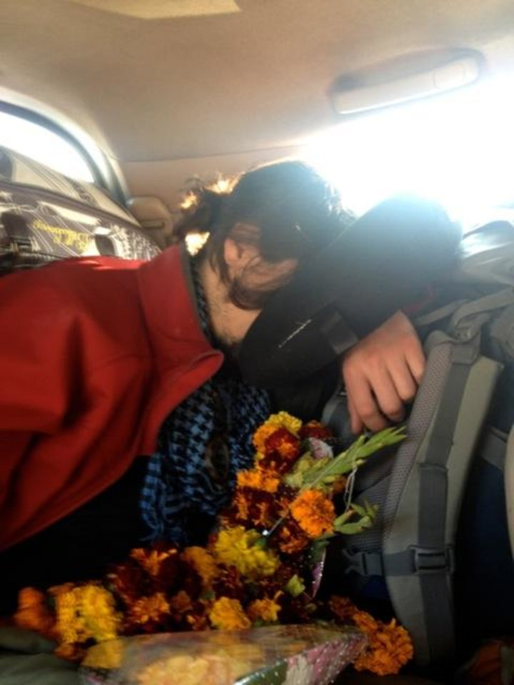 Photo -  Too many bags. Lots of flowers. Faces smashed into pillows. Life on the road in India.
