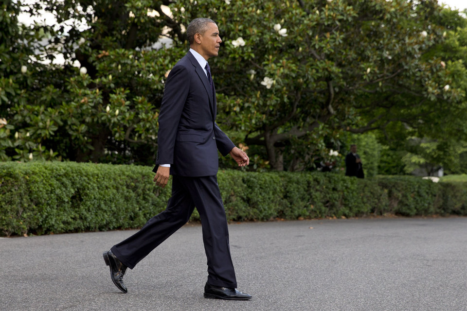 Photo - President Barack Obama walks to the Marine One helicopter on the South Lawn of the White House in Washington, for a trip to Warsaw, Poland, Monday, June 2, 2014. (AP Photo/Jacquelyn Martin)