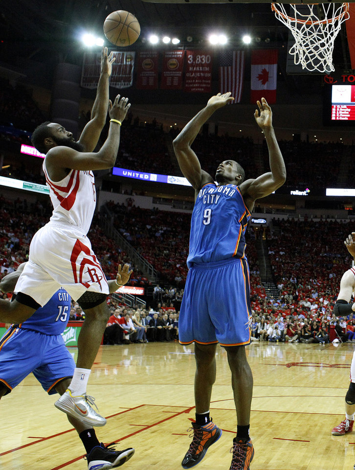 Photo - Houston's James Harden (13) drives to the basket as Oklahoma City's Serge Ibaka (9) defends during Game 4 in the first round of the NBA playoffs between the Oklahoma City Thunder and the Houston Rockets at the Toyota Center in Houston, Texas, Monday, April 29, 2013. Photo by Bryan Terry, The Oklahoman
