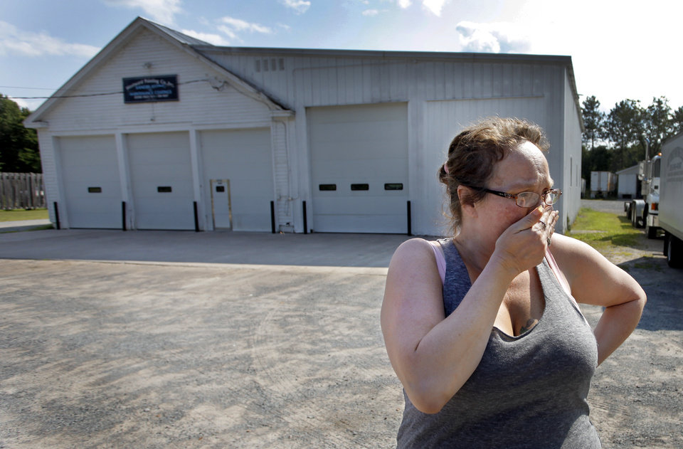 Photo - Lynn Hardy cries Sunday Aug. 10, 2014, in front of the Westward Painting Co. Inc in Lyons Falls, N.Y., where race car driver Kevin Ward Jr. kept and worked on his car and worked with his father Kevin Sr. in the painting business.  Hardy was married to Kevoin Sr's brother and says she still considers Kevin Jr her nephew.    Kevin Ward Jr was killed Saturday night in an accident at Canandaigua Motorsports Park when he left his car on the track after a crash and was hit by driver Tony Stewart while gesturing at him.  (AP Photo/Democrat & Chronicle, Annette Lein)  MAGS OUT; NO SALES