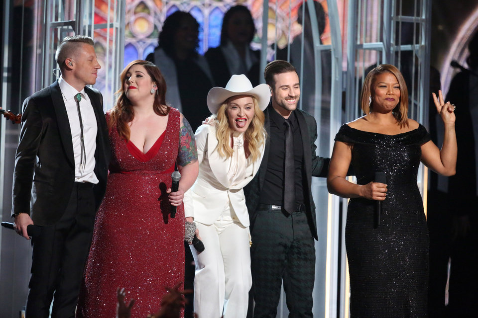 """Photo - Performers, from left, Macklemore, Mary Lambert, Madonna, Ryan Lewis and Queen Latifah appear on stage during a performance of """"Same Love"""" at the 56th annual Grammy Awards at Staples Center on Sunday, Jan. 26, 2014, in Los Angeles. (Photo by Matt Sayles/Invision/AP)"""