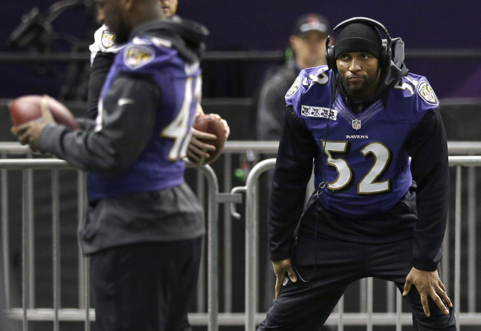 Photo - Baltimore Ravens linebacker Ray Lewis stretches during an NFL Super Bowl XLVII walkthrough on Saturday, Feb. 2, 2013, in the Mercedes-Benz Superdome in New Orleans. The Ravens face the San Francisco 49ers in Super Bowl XLVII on Sunday. (AP Photo/Patrick Semansky)