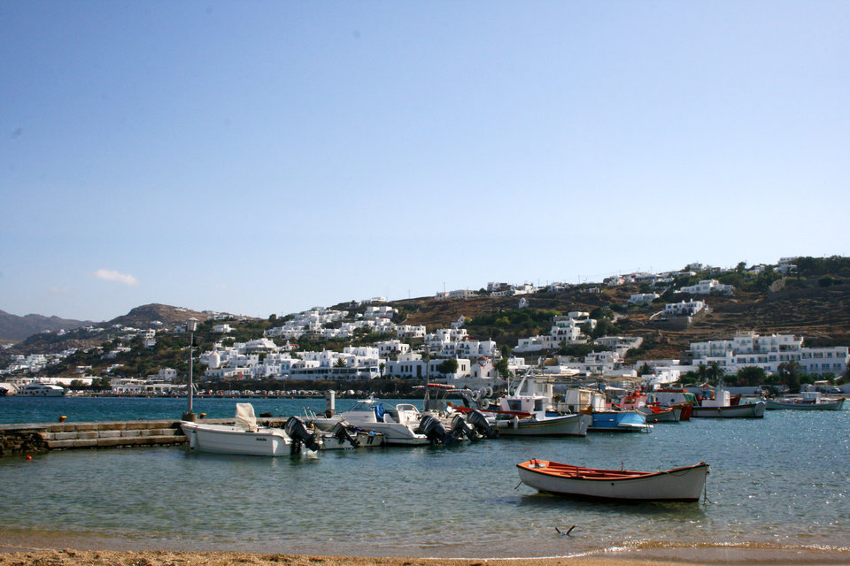 Photo - This July 2014 photo shows boats moored in the waters off Mykonos, part of Greece's Cyclades island chain in the Aegean Sea. The Cyclades are known for panoramic waterfront views, black-sand beaches and dramatic sunsets. (AP Photo/Kristi Eaton)