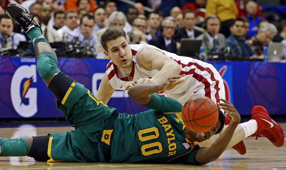 Photo - Oklahoma's Tyler Neal (15) dives for the ball beside Baylor's Royce O'Neale (00) during the Big 12 Tournament college basketball game between the University of Oklahoma and Baylor at the Sprint Center in Kansas City, Mo., Thursday, March 13, 2014. Baylor won 78-73.  Photo by Bryan Terry, The Oklahoman