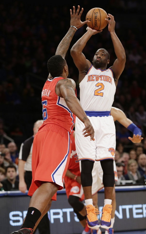 New York Knicks' Raymond Felton (2) shoots over Los Angeles Clippers' DeAndre Jordan (6) during the first half of an NBA basketball game on Sunday, Feb. 10, 2013, in New York. (AP Photo/Frank Franklin II)