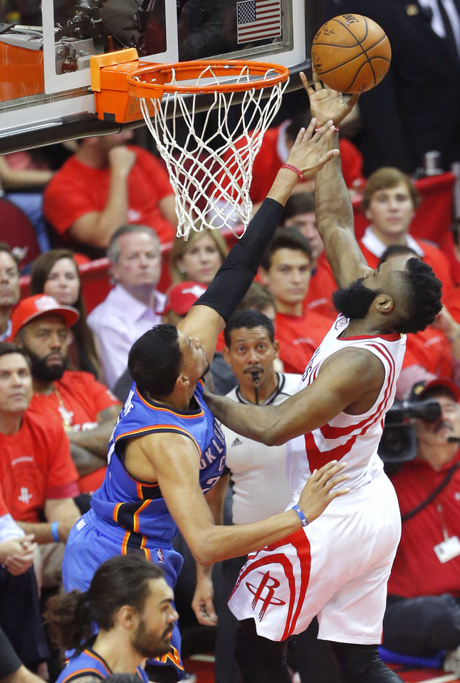Photo - Houston's James Harden (13) shots over Oklahoma City's Andre Roberson (21) during Game 5 in the first round of the NBA playoffs between the Oklahoma City Thunder and the Houston Rockets at the Toyota Center in Houston, Texas,  Tuesday, April 25, 2017.  Photo by Sarah Phipps, The Oklahoman