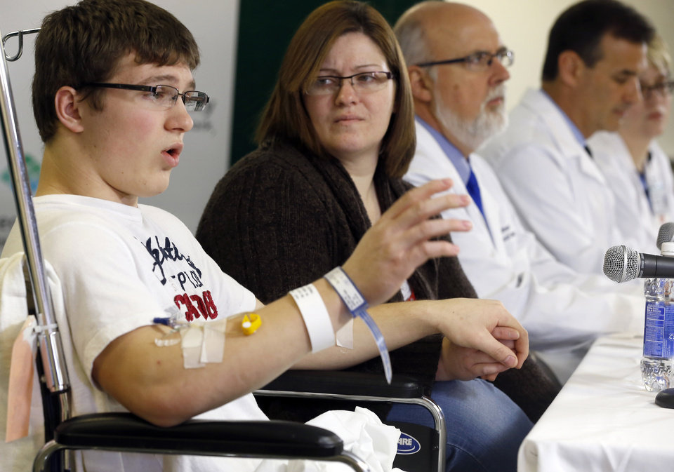 Photo - Brett Hurt, 16, a sophomore at Franklin Regional High School in Murrysville, Pa., and a victim in the stabbings that took place on April 9 at his high school, talks about the attack during a news conference at Forbes Regional Hospital, Thursday, April 10, 2014, in Monroeville, Pa. Authorities have charged Alex Hribal, 16, with four counts of attempted homicide and 21 counts of aggravated assault in the attacks. (AP Photo/Keith Srakocic)