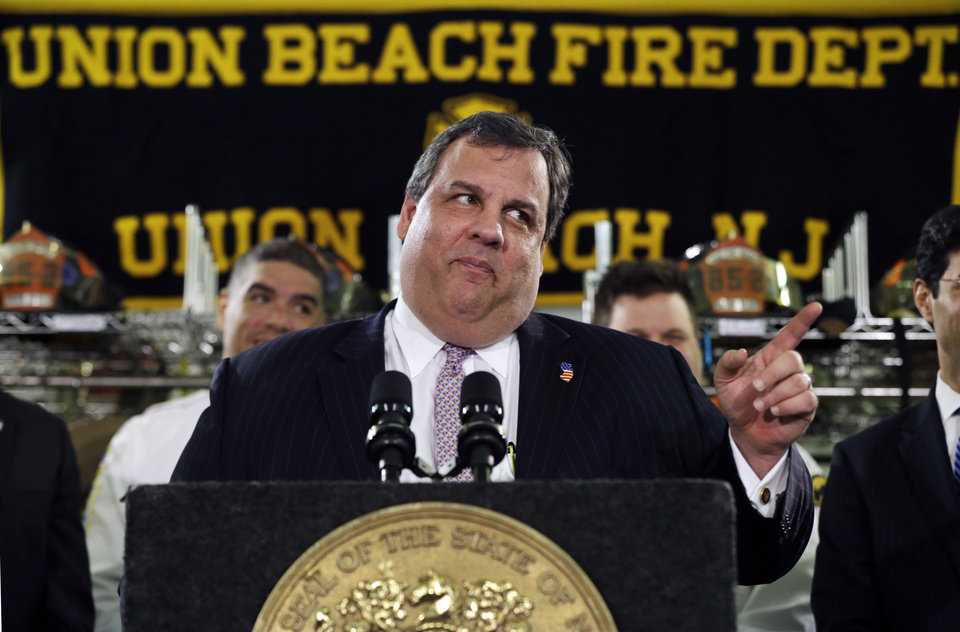Photo - New Jersey Gov. Chris Christie feigns a stern look Tuesday, Feb. 5, 2013, in Union Beach, N.J., after his was playfully asked about his weight. Christie has termed his plumpness