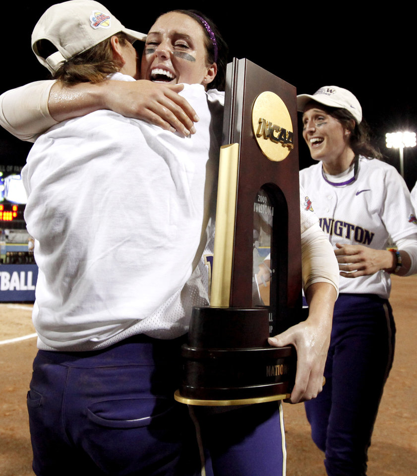 Photo - Washington's Danielle Lawrie, center, hugs Aly McWherter in front of Amanda Fleischman after their win over Florida in the second softball game of the championship series between Washington and Florida in Women's College World Series at ASA Hall of Fame Stadium in Oklahoma City, Tuesday, June 2, 2009. Photo by Bryan Terry, The Oklahoman