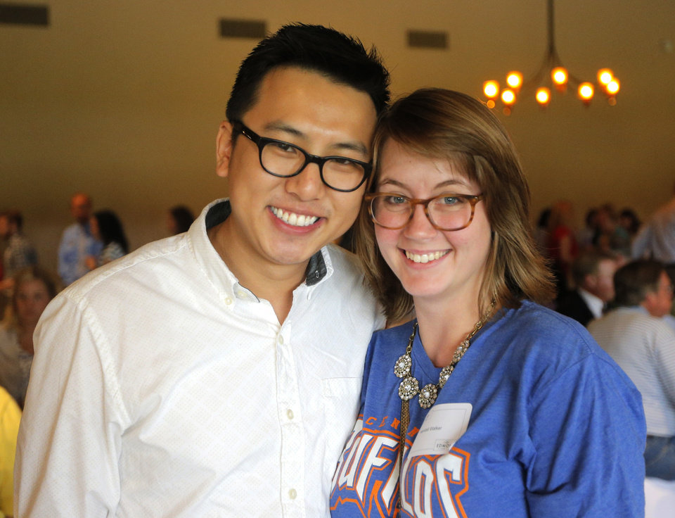 Photo -  New teacher Kendall Walker and friend, Kyven Zhao, pose during a new teachers reception at Oak Tree Golf and Country Club. PHOTO BY SARAH PHIPPS, THE OKLAHOMAN   SARAH PHIPPS -