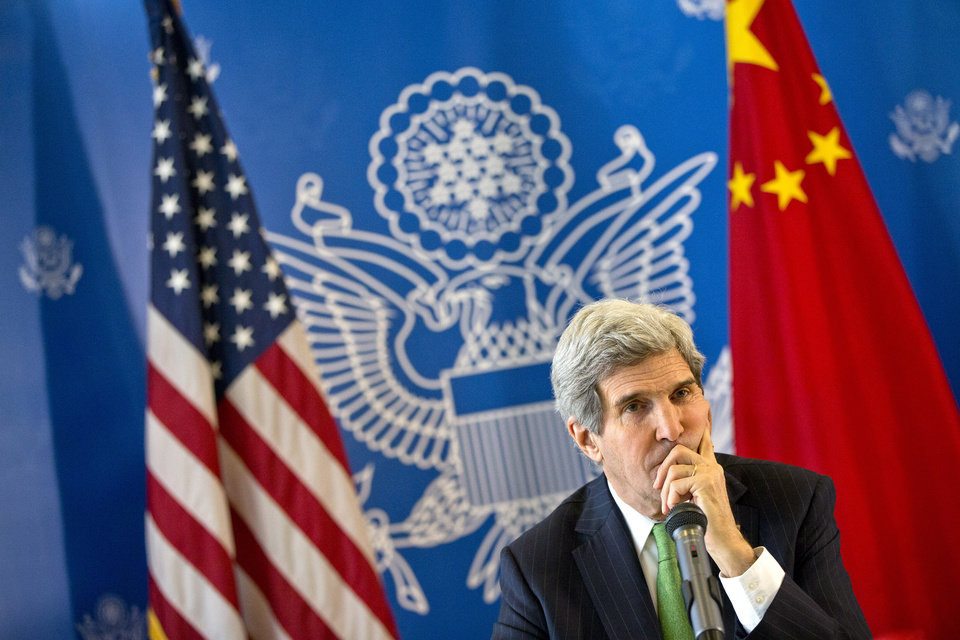 Photo - U.S. Secretary of State John Kerry listens to a question during a discussion with Chinese bloggers on a number of issues, including internet freedom, Chinese territorial disputes with Japan, North Korea, and human rights, on Saturday, Feb. 15, 2014, in Beijing, China. (AP Photo/Evan Vucci, Pool)