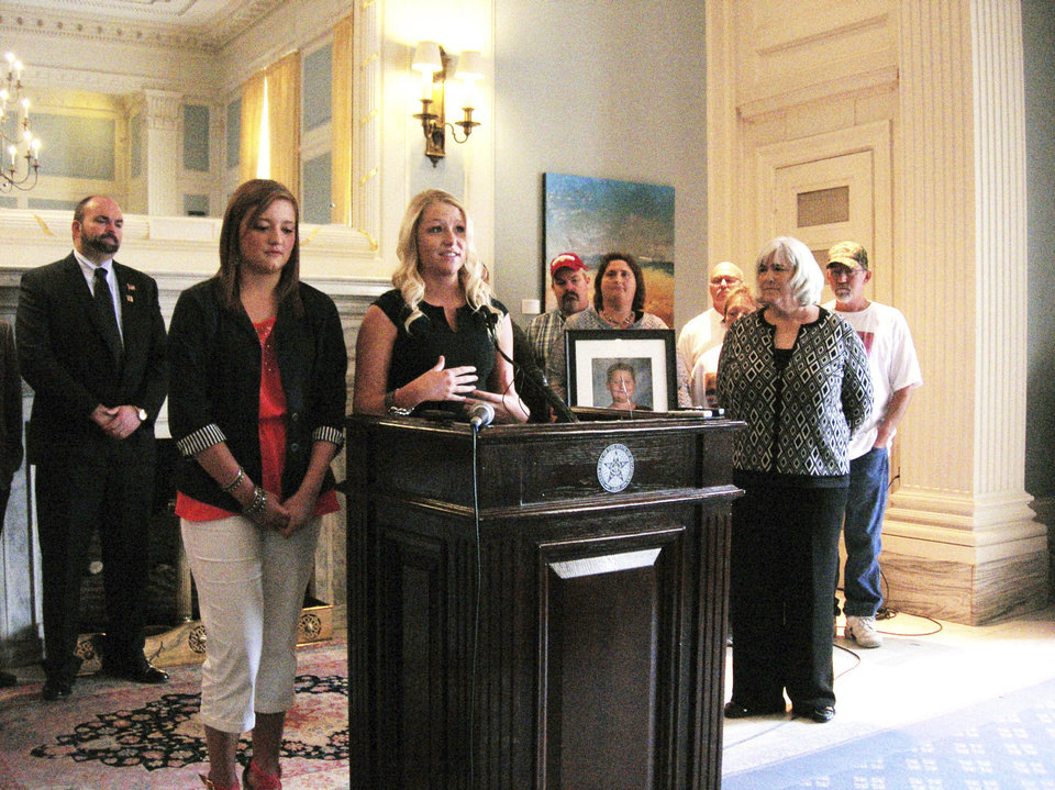 Photo - Mikayla Cooper, a senior at Bridge Creek High School, and Kylie Carroll, a senior at Fletcher High School, stand with chairwoman of Take Shelter Oklahoma Kathy Turner at a press conference announcing the filing of a petition to put a bond issue to pay for school storm shelters on a statewide ballot in the Blue Room at the Capitol Wednesday September 18, 2013. Photo by Graham Brewer, The Oklahoman