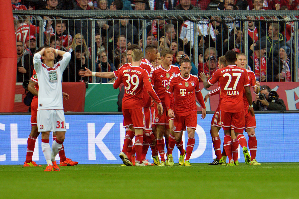 Photo - Bayern Munich's players celebrate after scoring during the German soccer cup, DFB Pokal, semifinal soccer match between FC Bayern Munich and FC Kaiserslautern in the Allianz Arena in Munich, Germany, on Wednesday, April 16. 2014. (AP Photo/Kerstin Joensson)