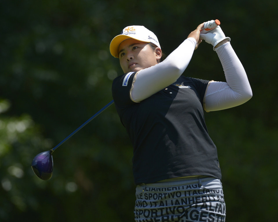 Photo - Inbee Park of South Korea hits her tee shot on the fifth hole during the second round of the Airbus LPGA Classic golf tournament at Magnolia Grove on Friday, May 23, 2014, in Mobile, Ala. (AP Photo/G.M. Andrews)