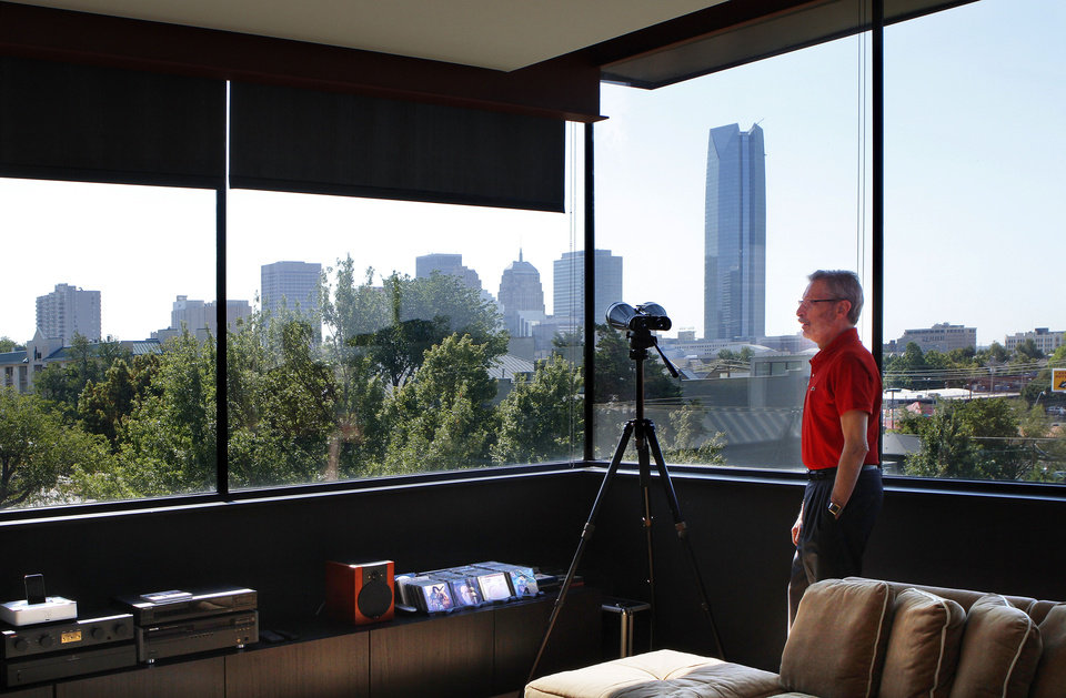 Photo - Left: Walls of windows give Bill Lovallo a panoramic view of downtown Oklahoma City from his home at 825 NW 7. Photos by Jim Beckel, THE OKLAHOMAN
