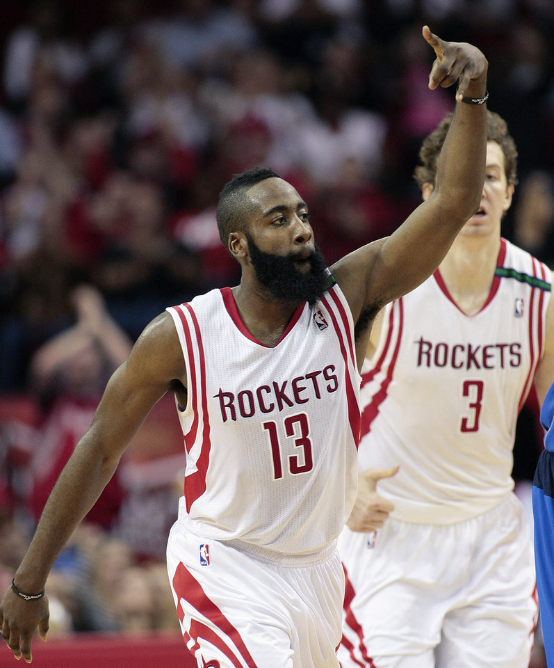 Photo - Houston Rockets' James Harden (13) motions after hitting a three-point shot against the Dallas Mavericks during the first half of an NBA basketball game, Saturday, Dec. 8,  2012, in Houston. (AP Photo/Bob Levey)