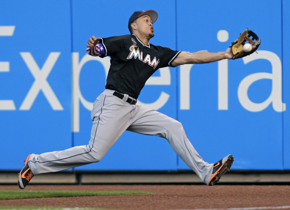 Photo - Miami Marlins right fielder Giancarlo Stanton cannot quite reach an RBI-double hit by St. Louis Cardinals' Yadier Molina in the sixth inning of a baseball game on Friday, July 4, 2014, in St. Louis.(AP Photo/Tom Gannam)