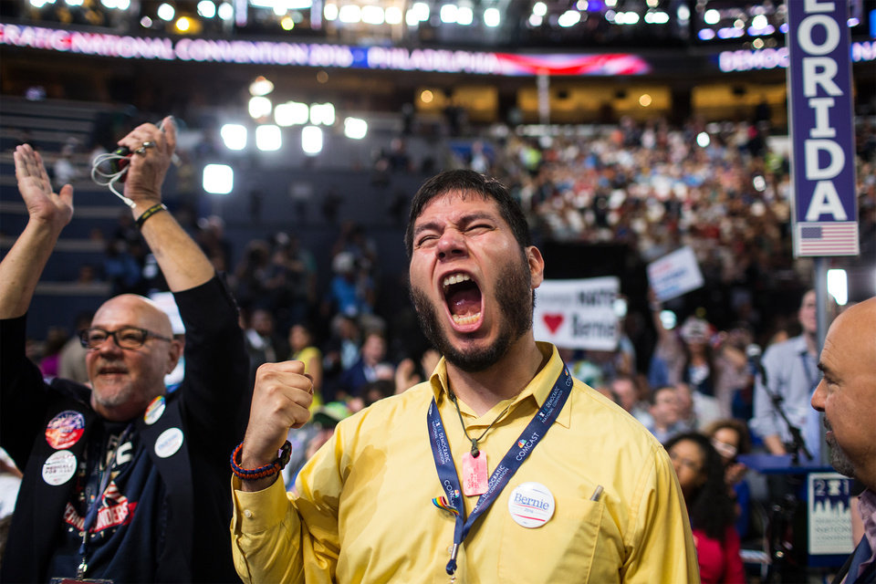 Photo - A supporter of Former Democratic presidential candidate, Sen. Bernie Sanders, I-Vt., cheers during the first day of the Democratic National Convention in Philadelphia, Monday, July 25, 2016. (Sean Simmers/PennLive.com via AP)
