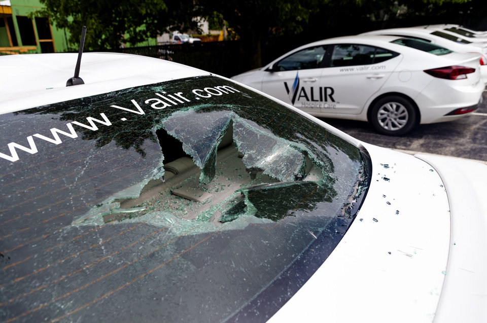 Photo - Damage to the Valir Hospice Care vehicles on Monday, June 1, 2020, in Oklahoma City, Okla. that was left behind after the George Floyd protest on Sunday.    [Chris Landsberger/The Oklahoman]
